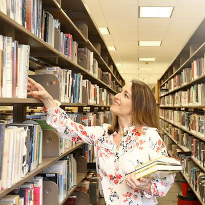 Photo of staff selecting books