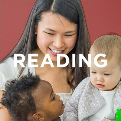 photo of mother reading with babies
