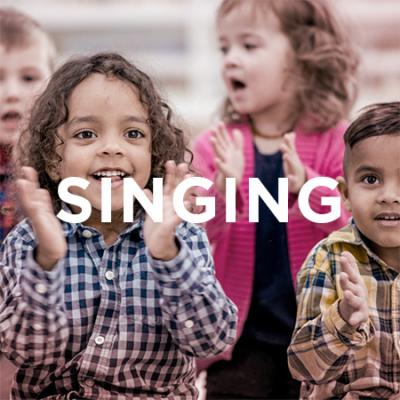 photo of kids singing and clapping