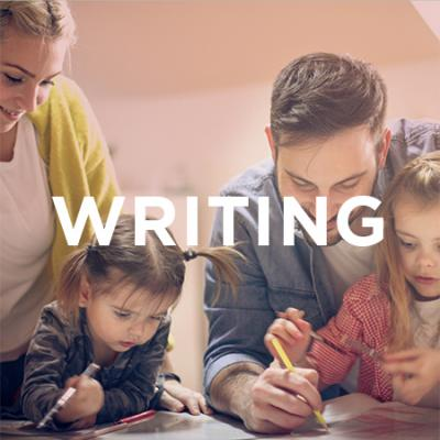 Photo of kids and parents writing together