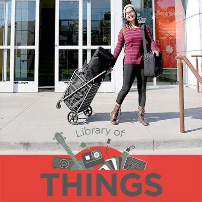 Photo of woman borrowing projector wth Library of Things logo