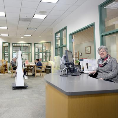 photo of staff and customers in senior center reading room