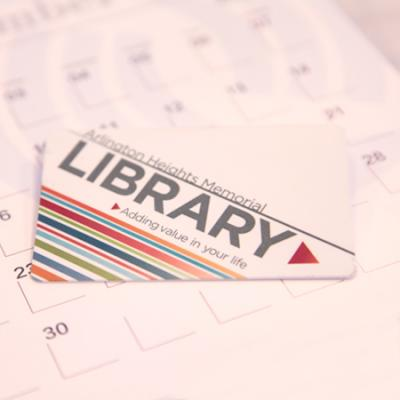 library card laying on a calendar
