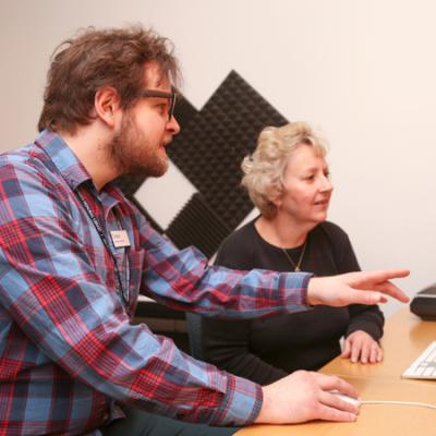 staff helping studio user