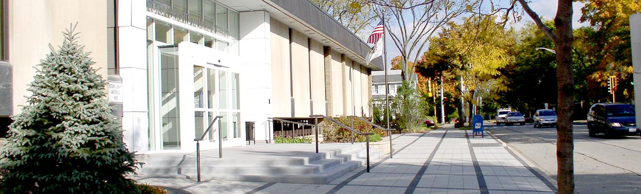 Photo of library front door and sidewalk